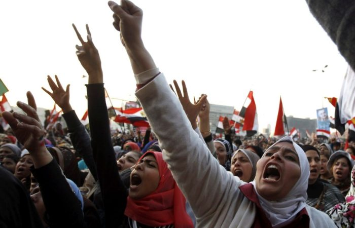 Women shout during a protest in Tahrir Square in Cairo January 25, 2013. Protesters clashed with police across Egypt on Friday on the second anniversary of the revolt that toppled Hosni Mubarak, taking to the streets against the elected Islamist president who they accuse of betraying the revolution . REUTERS/Mohamed Abd El Ghany (EGYPT - Tags: POLITICS CIVIL UNREST)