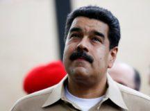 Venezuela's President Nicolas Maduro waits the arrival of Colombia's President Juan Manuel Santos at Macagua Hydroelectric compound in Puerto Ordaz, Venezuela, August 11, 2016. REUTERS/Carlos Garcia Rawlins