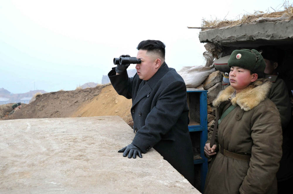 FILE - In this March 7, 2013 file photo released by the Korean Central News Agency (KCNA) and distributed by the Korea News Service, North Korean leader Kim Jong Un uses a pair of binoculars to look at the South's territory from an observation post at the military unit on Jangjae islet, located in the southernmost part of the southwestern sector of North Korea's border with South Korea. For the outside world, North Korea's message is largely doom and gloom: bombastic threats of nuclear war, amateur-looking videos showing U.S. cities in flames, digitally altered photos of military drills. But a domestic audience gets a parallel and decidedly softer dose of propaganda - and one with potentially higher stakes for the country's young leader. (AP Photo/KCNA via KNS, File)